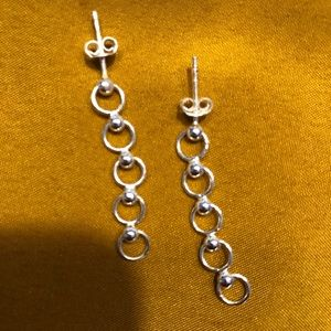 Sterling silver dangling circular stud earrings